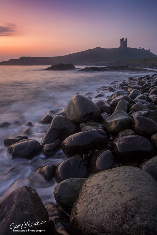 Dunstanburgh castle at dawn. Landscape photography by Gary Waidson.