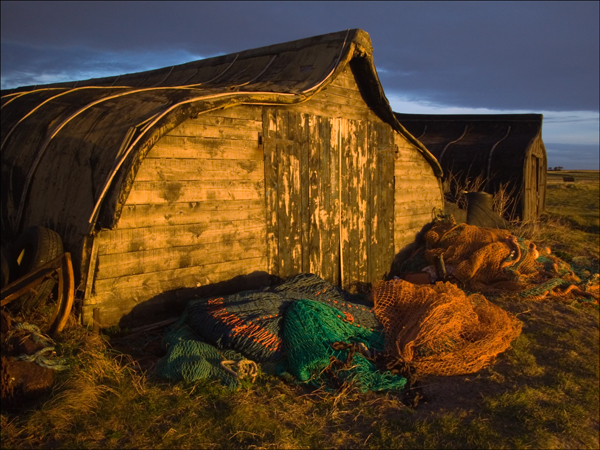 Upturned herring boat hut on Lindisfarne. Landscape photography by Gary Waidson.